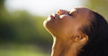 Beautiful Black Woman Feeling The Sun On Her Face Stock Photos - 47558803
