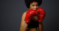 Strong Black Woman Athlete With Boxing Gloves Royalty Free Stock Image - 47558816