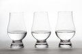 Vodka In Three Crystal Tasting Glasses Stock Photography - 47564792