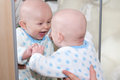 Laughing Baby Looking In Mirror Stock Image - 47574311