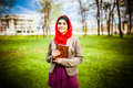 Beautiful Muslim Woman Wearing Hijab And Holding A Holy Book Koran. Stock Images - 47595264