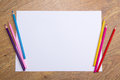 Colorful Drawing Pencils And Blank Paper On Wooden Table Royalty Free Stock Photo - 47616495