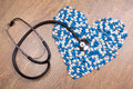 Stethoscope And Heart Made Of Blue Tablets, Pills Or Capsules Stock Photography - 47616562