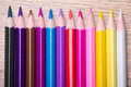 Row Of Many Colored Drawing Pencils On Wooden Table Stock Photography - 47616692