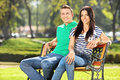 Young Couple Sitting On A Bench In Park Royalty Free Stock Image - 47619206