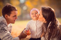 Happy Young Family Spending Time Outdoor In The Autumn Park Stock Photography - 47620972
