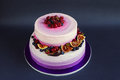 Two Tiered Purple Cake With Fruit On Dark Background Stock Photos - 47638093