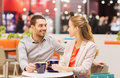 Happy Couple With Shopping Bags Drinking Coffee Stock Photo - 47640710