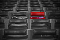 Single Red Chair In Amongst Monochrome Chairs Royalty Free Stock Photography - 47654267