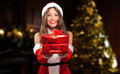 Female Santa Claus Giving You A Present Royalty Free Stock Image - 47667066