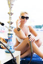 Woman With Hookah On The Beach Royalty Free Stock Image - 47676186