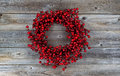 Red Berry Holiday Wreath On Wood Stock Images - 47676974