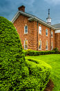 Storm Clouds Over Bushes And A Building At The Lutheran Seminary Stock Photos - 47695463