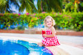Little Girl Drinking Juice At A Swimming Pool Stock Images - 47697004