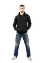 Young Confident Man In Hood With Hands In Pocket Looking At Camera Stock Image - 47697681