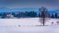 View Of Snow-covered Farm Fields And Distant Mountains From Long Royalty Free Stock Photography - 47706287
