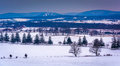 View Of Snow-covered Farm Fields And Distant Mountains From Long Royalty Free Stock Images - 47706369
