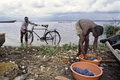 Washing And Polishing At Lake Victoria, Uganda Stock Photo - 47720190