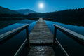 Dock At Night With Full Moon Royalty Free Stock Photo - 47722495