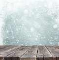 Rustic Wooden Table In Front Of Silver And White Bokeh Defocused Lights With Snowflake . Abstract Background Royalty Free Stock Photography - 47723297