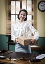 Smiling Young Secretary Holding A Mail Package Stock Photo - 47724440