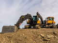 Excavator On A Road Construction Site Royalty Free Stock Photos - 47726478