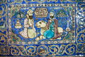 Ceramic Tiles Of 19th Century With A Lion & Two Persian Men Talking In Garden Royalty Free Stock Images - 47750039