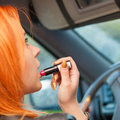 Girl Painting Her Lips Doing Make Up While Driving The Car. Royalty Free Stock Photography - 47751777