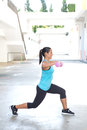 Hispanic Sport Woman Doing Lunges With Two Pink Dumbbell, Outdoor. Stock Photography - 47771872