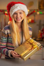 Teenager Girl In Santa Hat With Present Box Royalty Free Stock Photography - 47774817