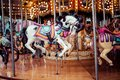 Old French Carousel In A Holiday Park. Three Horses And Airplane On A Traditional Fairground Vintage Carousel. Merry-go-round With Stock Photo - 47778860