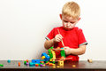 Little Boy Child Playing With Building Blocks Toys Interior. Stock Photo - 47788470