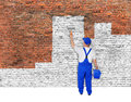 House Painter Covers Brick Wall With White Paint Stock Photography - 47811452