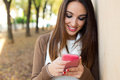 Beautiful Girl Chatting With Mobile Phone In Autumn. Stock Images - 47812124