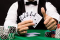 Poker Player With Cards And Chips At Casino Stock Photos - 47830113