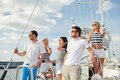 Smiling Friends Sailing On Yacht Stock Images - 47830604