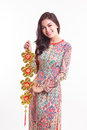 Beautiful Vietnamese Woman Wearing Impression Ao Dai Holding Lucky Decorate Object Royalty Free Stock Photo - 47860375