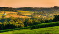 View Of Rolling Hills And Farm Fields At Sunset, In Rural York C Royalty Free Stock Photography - 47864007