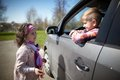 Girl And Boy Driving Fathers Car Royalty Free Stock Photos - 47865198