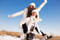Two Girlfriends Have Fun And Enjoy Fresh Snow Royalty Free Stock Photos - 47866158