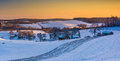 View Of Snow Covered Rolling Hills And Farm Fields At Sunset In Stock Photography - 47866562