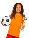 Little Black Girl Holding Soccer Ball And Prize Stock Photos - 47884093
