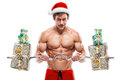 Muscular Santa Claus Doing Exercises With Gifts Over White Backg Royalty Free Stock Photo - 47889795