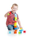 Kid Playing And Building High Tower With Colorful Stock Images - 47894564