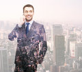 Smiling Young Businessman Over City Background Royalty Free Stock Photography - 47912247