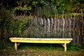 Antique Yellow Garden Bench And Old Vintage Fence Royalty Free Stock Photo - 47913035