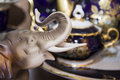 Little Figurine Of Elefant In Front Of Elegant Tableware Set Royalty Free Stock Photo - 47915845