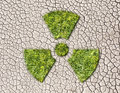 Radiation Sign From Grass  On Cracked Earth Background Stock Photos - 47950363