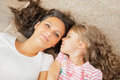 Mother And Little Daughter Whispering In Mother S Ear Royalty Free Stock Images - 47960999