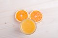 Glass Of Orange Fresh Juice On A Light Table And Orange Ears Top Stock Images - 47963154